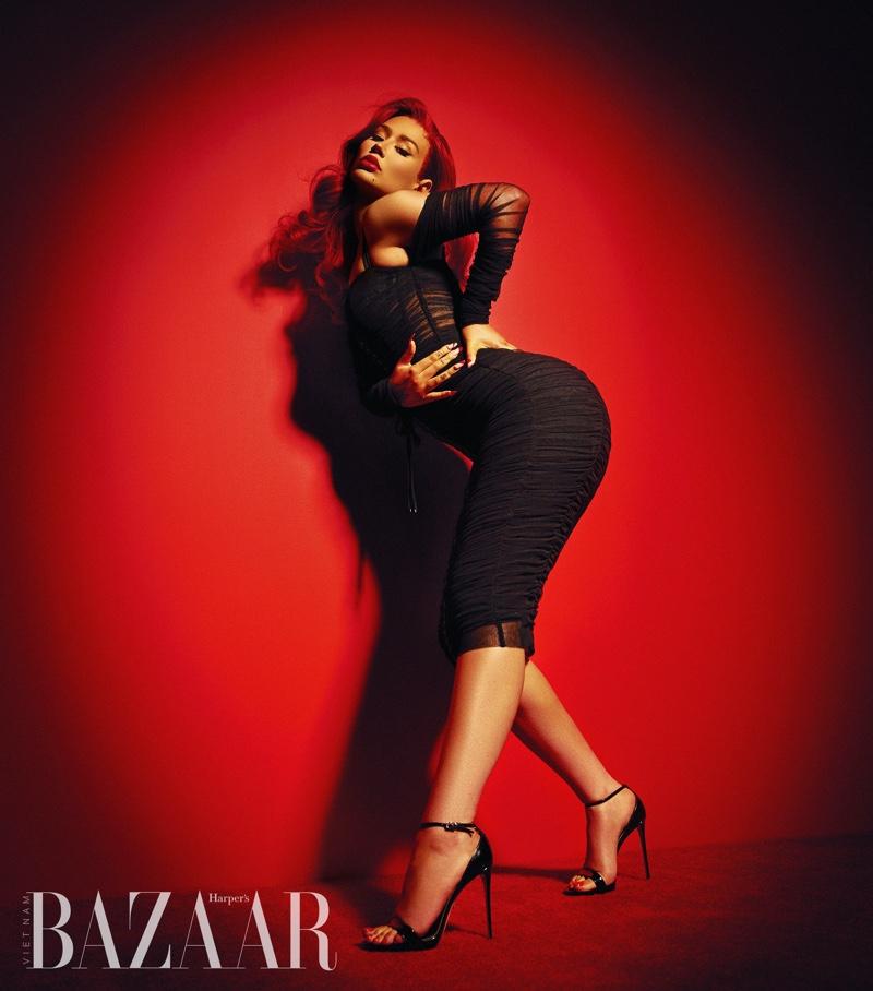 Wearing black, Iggy Azalea poses in Dolce & Gabbana dress with Le Silla heels. Photo: Thom Kerr / Harper's Bazaar Vietnam