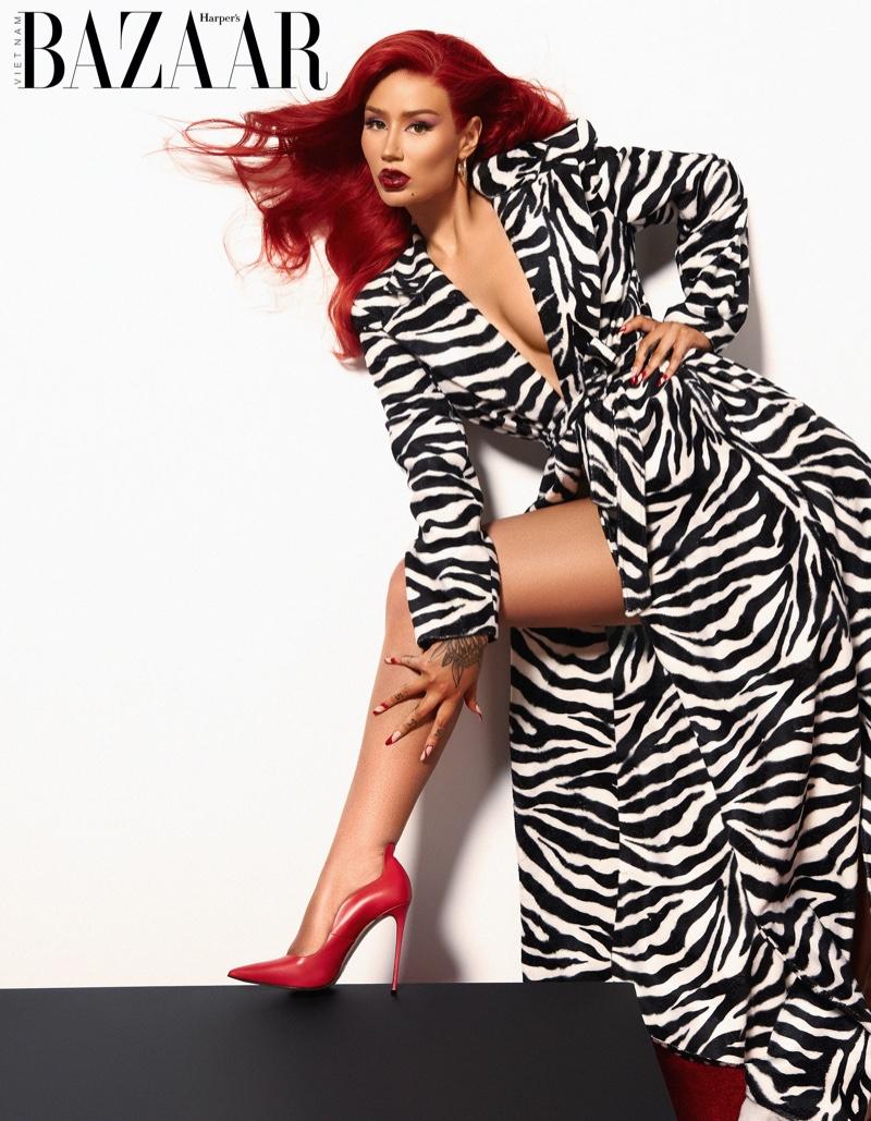 Striking a pose, Iggy Azalea wears zebra print dress. Photo: Thom Kerr / Harper's Bazaar Vietnam