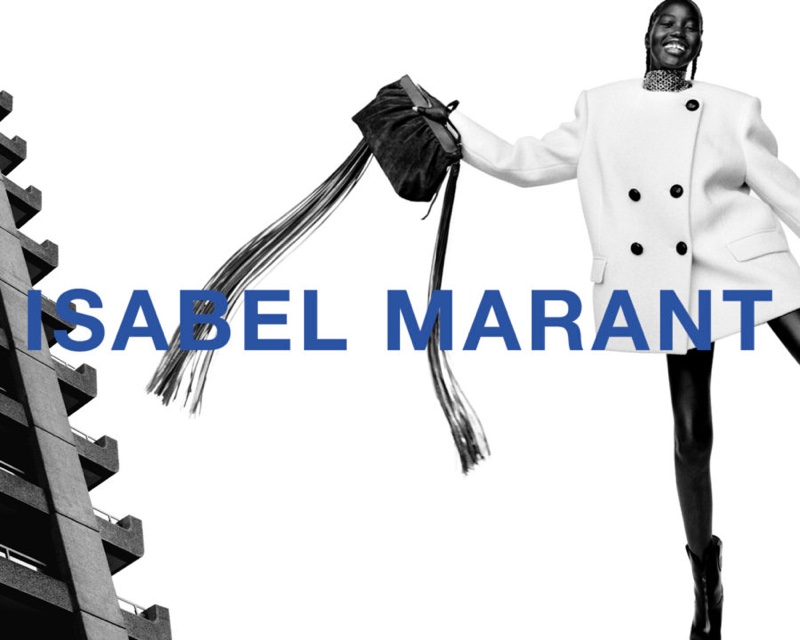 Model Adut Akech flashes a smile in Isabel Marant's fall-winter 2021 campaign.