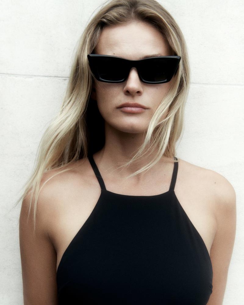 Edita Vilkeviciute Massimo Dutti halter neck swimsuit and cateye sunglasses.