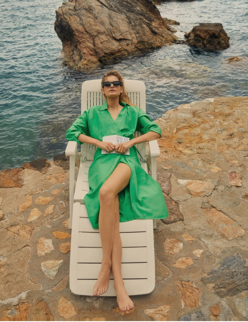 Posing with a book, Signe Veiteberg lounges in Massimo Dutti summer 2021 collection.