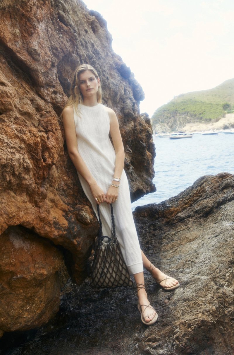 Signe Veiteberg wears white knit dress from Massimo Dutti summer 2021 collection.
