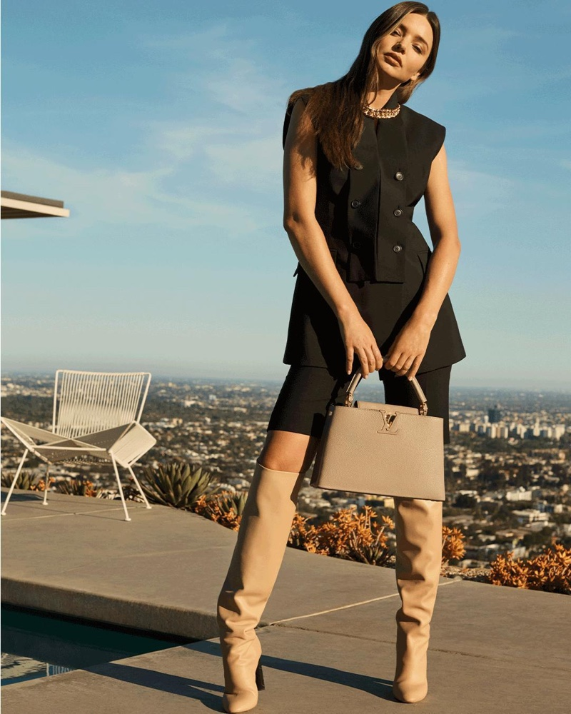Model Miranda Kerr poses with Louis Vuitton Capucines MMB bag in new campaign.
