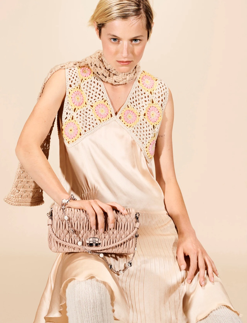 Posing in a crochet dress, Emma Corrin fronts Miu Miu fall-winter 2021 campaign.