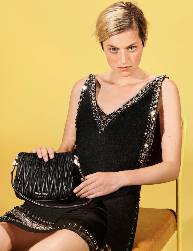 The Crown star wears a little black dress in the Miu Miu fall-winter 2021 campaign.