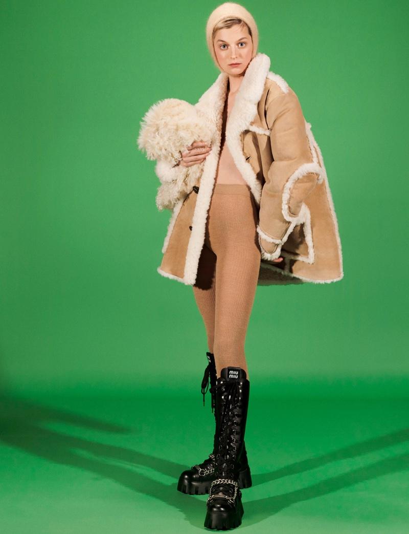 Posing against a green backdrop, Emma Corrin fronts Miu Miu fall-winter 2021 campaign.