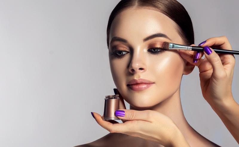 Model Getting Makeup Applied Eyeshadow Brush