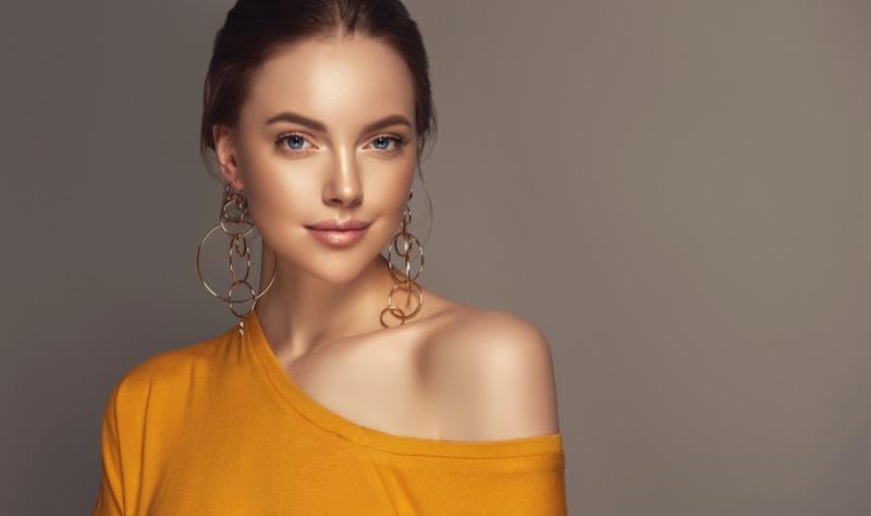 Model Gold Layered Hoop Earrings One Shoulder Top