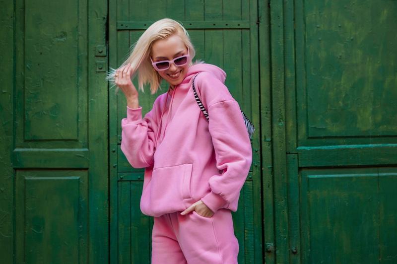 Model Pink Sweatshirt Pants Sunglasses Outfit