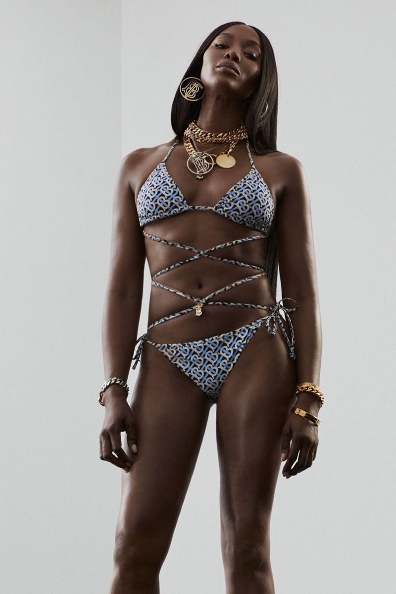 Flaunting her swimsuit body, Naomi Campbell wears a bikini in Burberry TB Summer Monogram campaign.