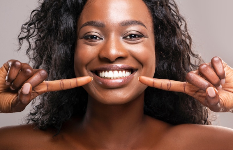 Smiling Black Woman Showing Healthy Teeth