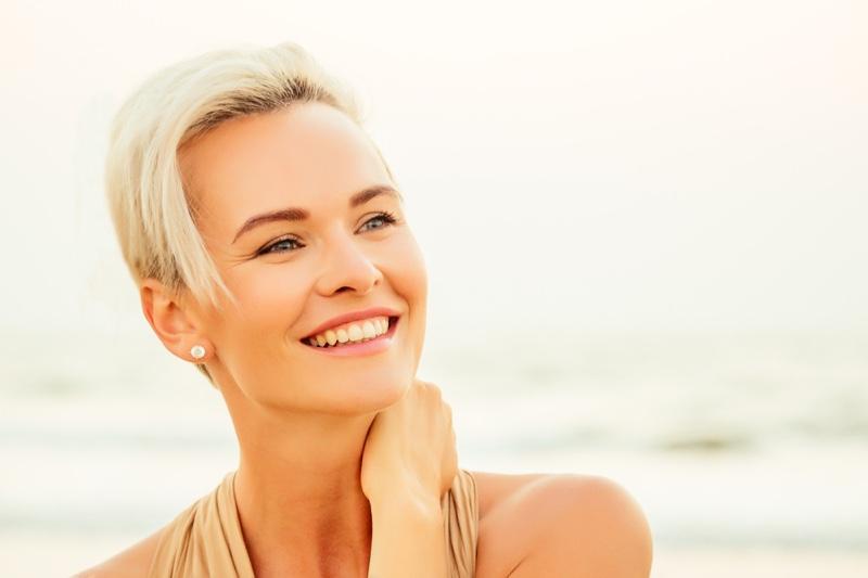 Smiling Older Woman Blonde Short Hair Sun Beauty