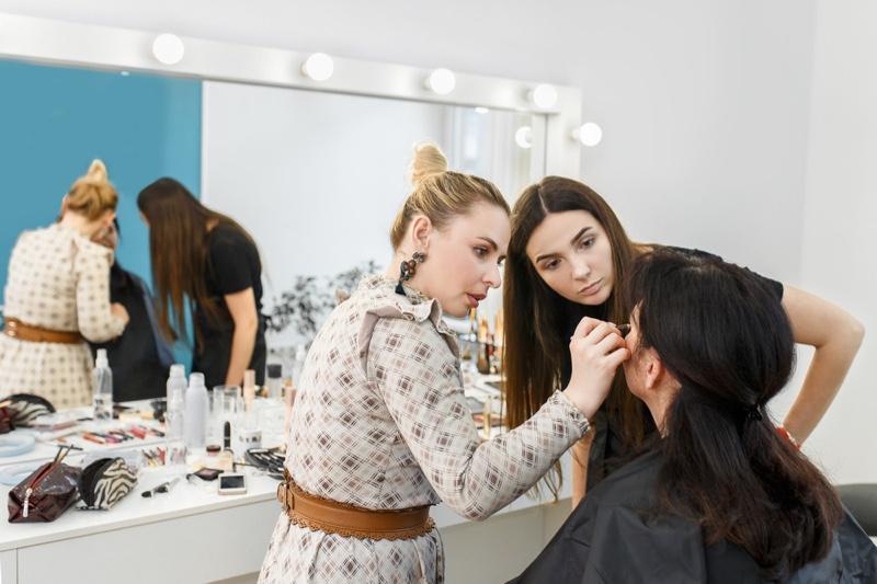 Teacher Showing Student Makeup Techniques