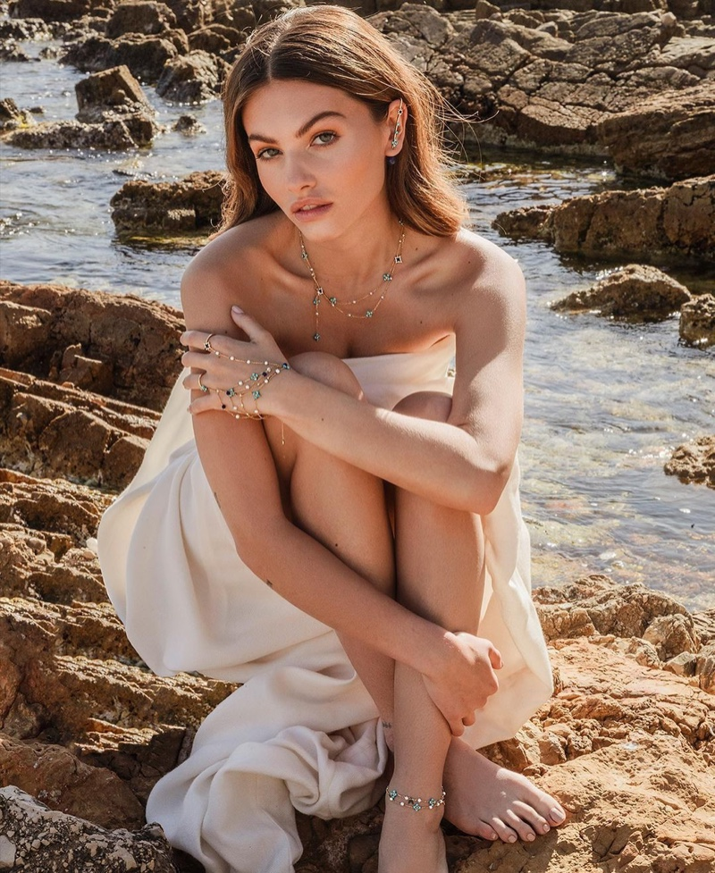 Posing on the sand, Thylane Blondeau wears APM Monaco ROMA collection.