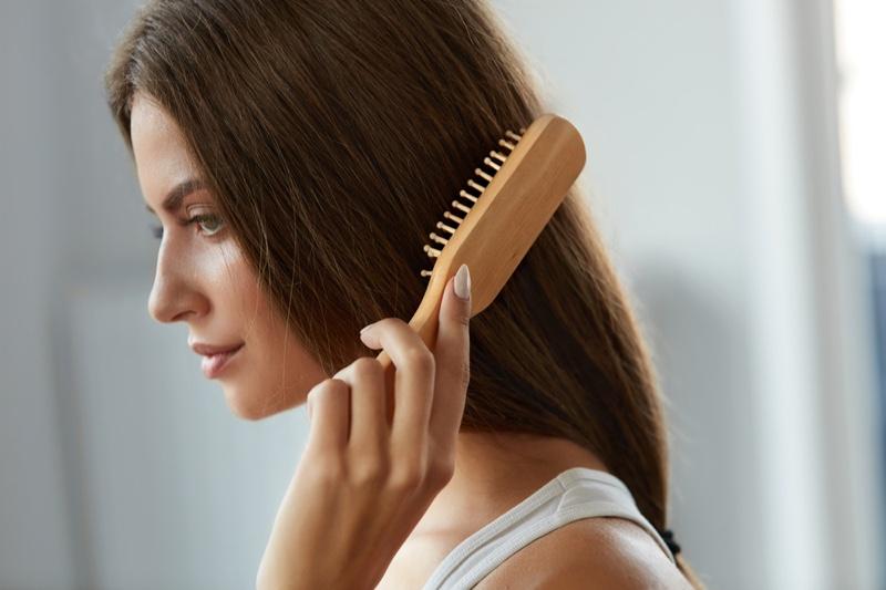 Woman Brushing Hair Closeup