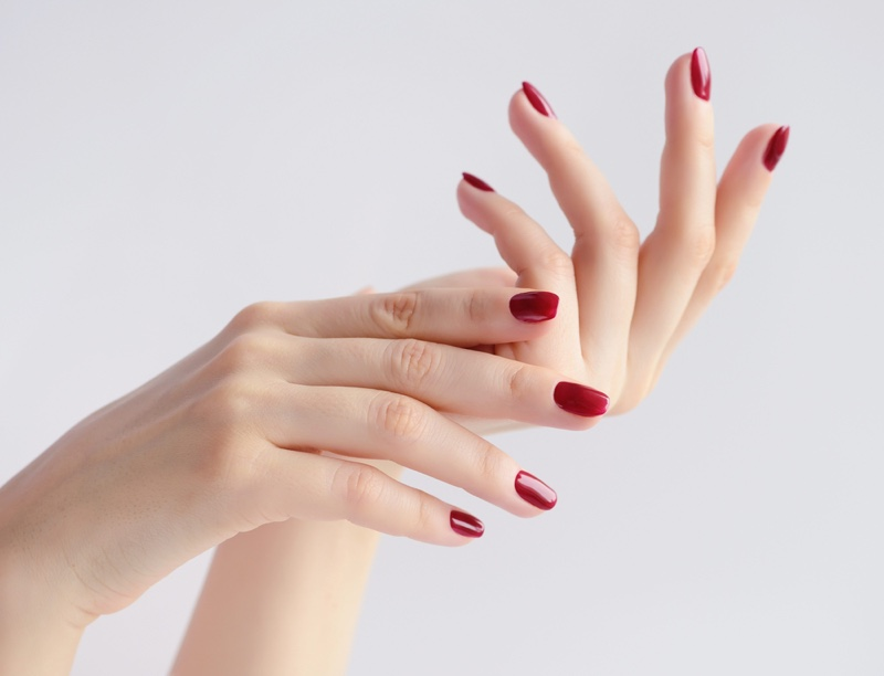Woman Dark Red Nails Manicure