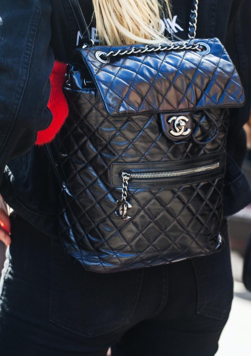 Woman Wearing Black Chanel Backpack Flap