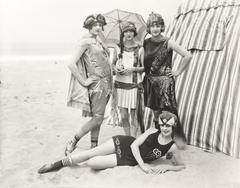 Women pose in wool swimsuits at the beach in the 1920s. Photo: Shutterstock.com