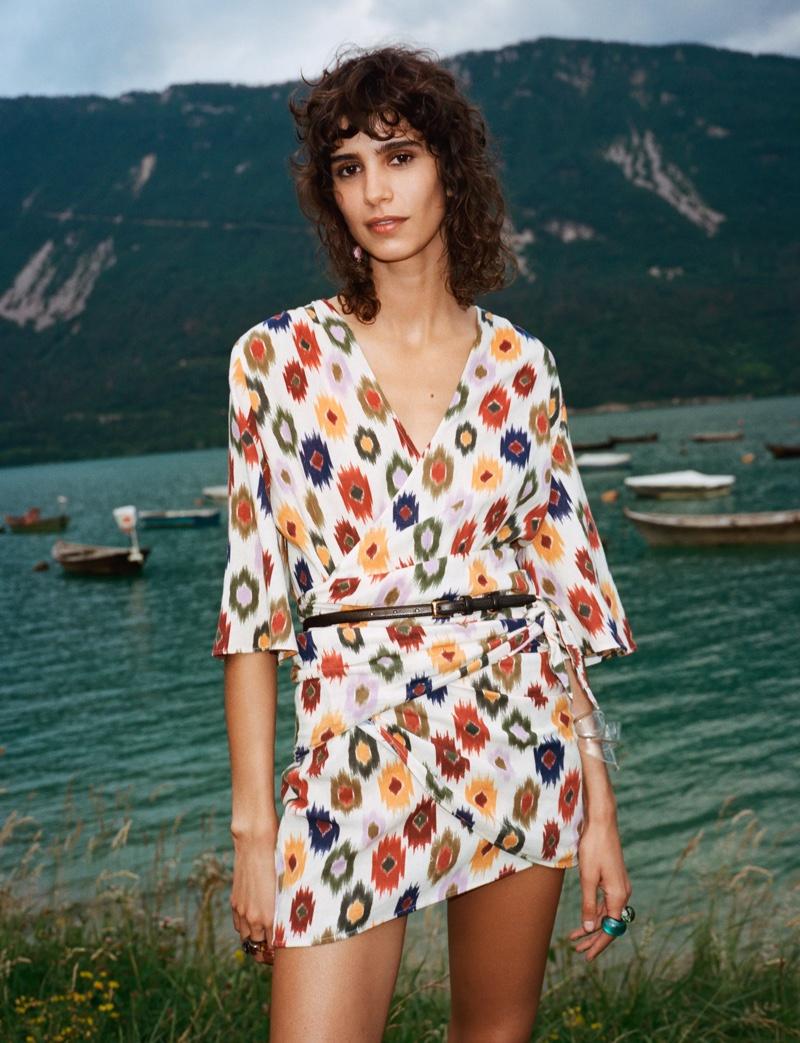 Mica Arganaraz wears Zara printed mini dress.