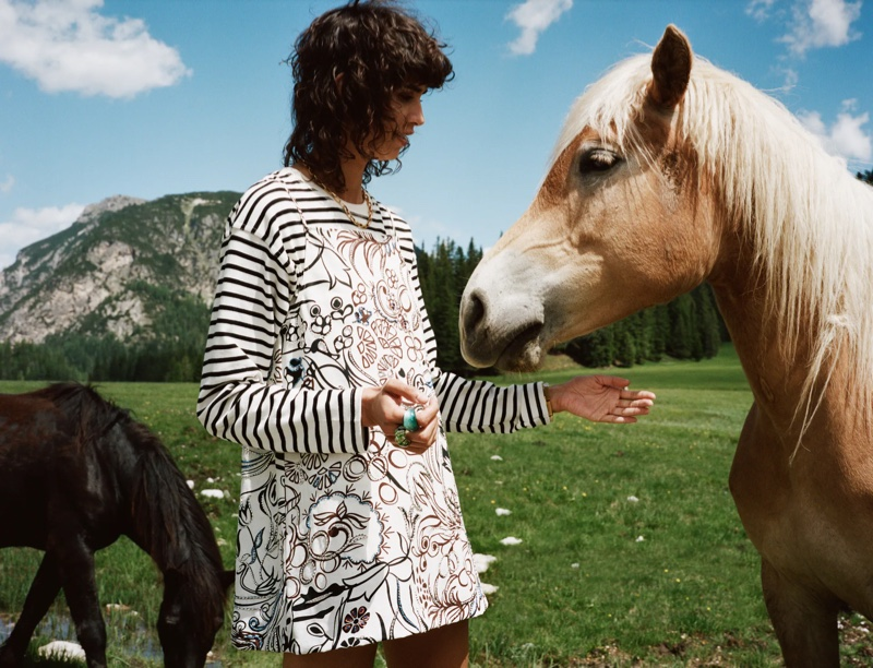Posing with a horse, the model fronts Zara Sulle Dolomiti summer 2021 editorial.