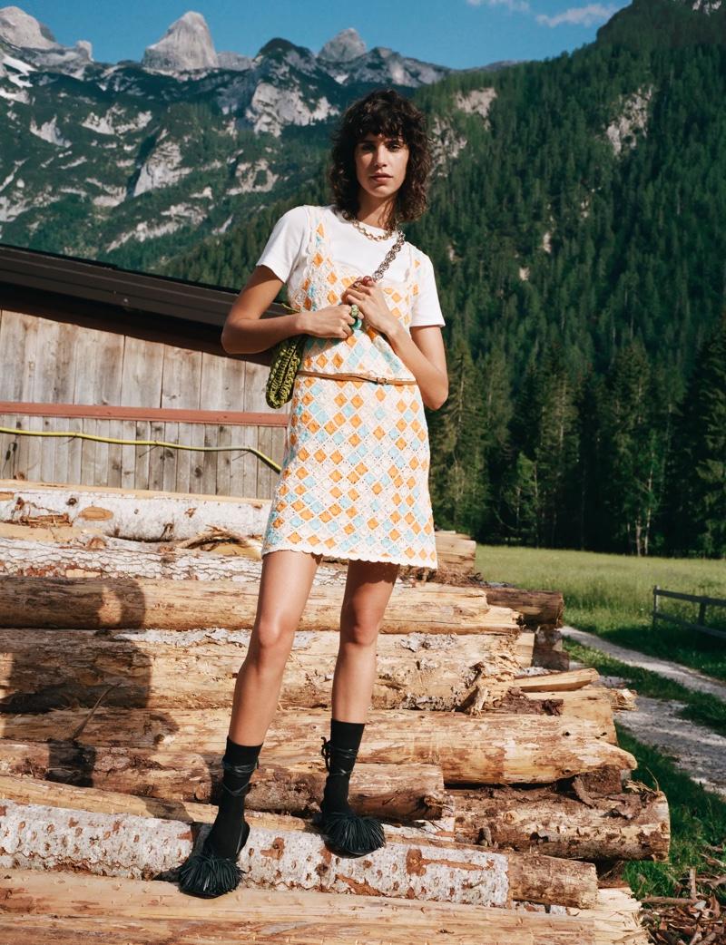 Mica Arganaraz wears a crochet mini dress in Zara Sulle Dolomiti summer 2021 editorial.