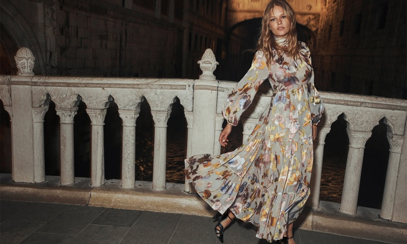 Anna Ewers wears Zimmermann Tempo swing maxi dress in brand's fall 2021 campaign.