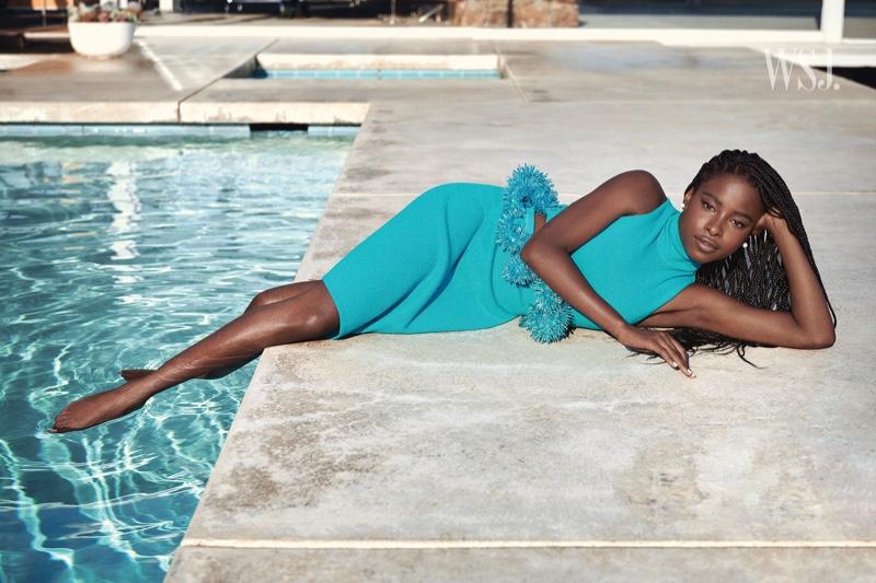 Posing poolside, Amanda Gorman wears Bottega Veneta design. Photo: Cass Bird for WSJ. Magazine