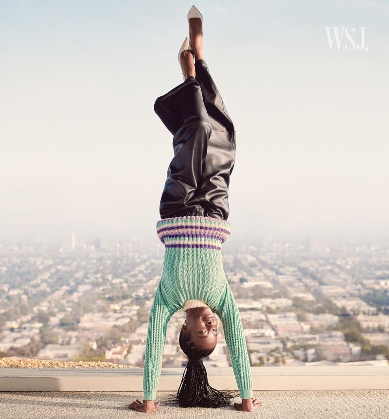Doing a handstand, Amanda Gorman wears Loewe outfit. Photo: Cass Bird for WSJ. Magazine