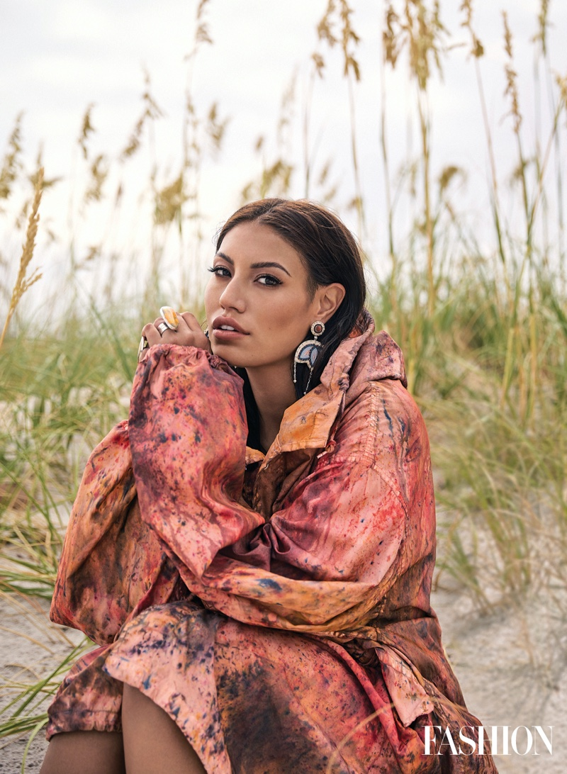 Actress and influencer Ashley Callingbull poses in 4Kinship jacket and rings.
