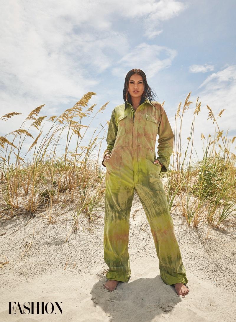 Ashley Callingbull wears green 4Kinship jumpsuit with Warren Steven Scott earrings. Photo: Gabor Jurina / FASHION