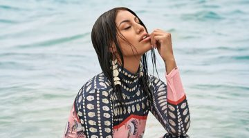 Posing in water, Ashley Callingbull wears Lauren Good Day dress and Indi City earrings. Photo: Gabor Jurina / FASHION