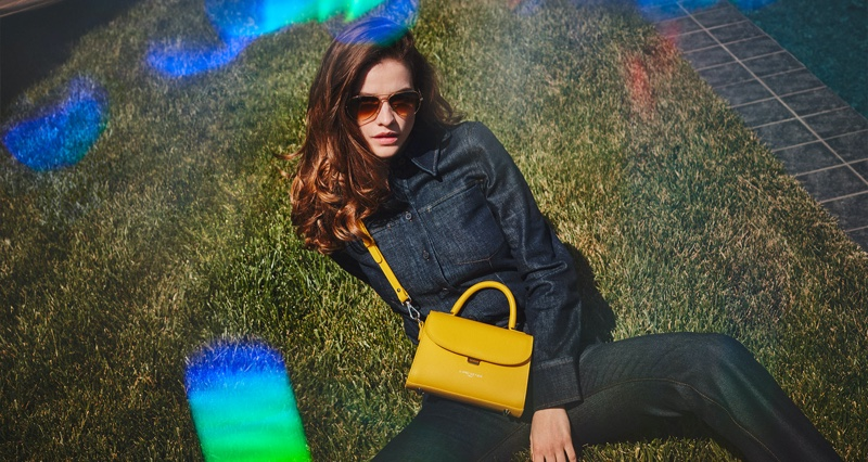 Lancaster highlights yellow mini handle bag in fall-winter 2021 campaign.