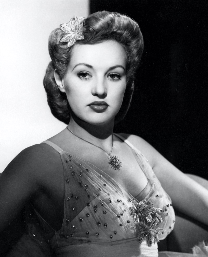 Actress Betty Grable poses with a sleek pompadour updo hairstyle. Photo: RGR Collection / Alamy Stock Photo