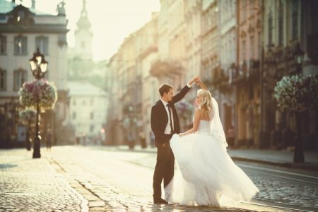 Bride Groom Cobblestone Streets Dancing Wedding Dress