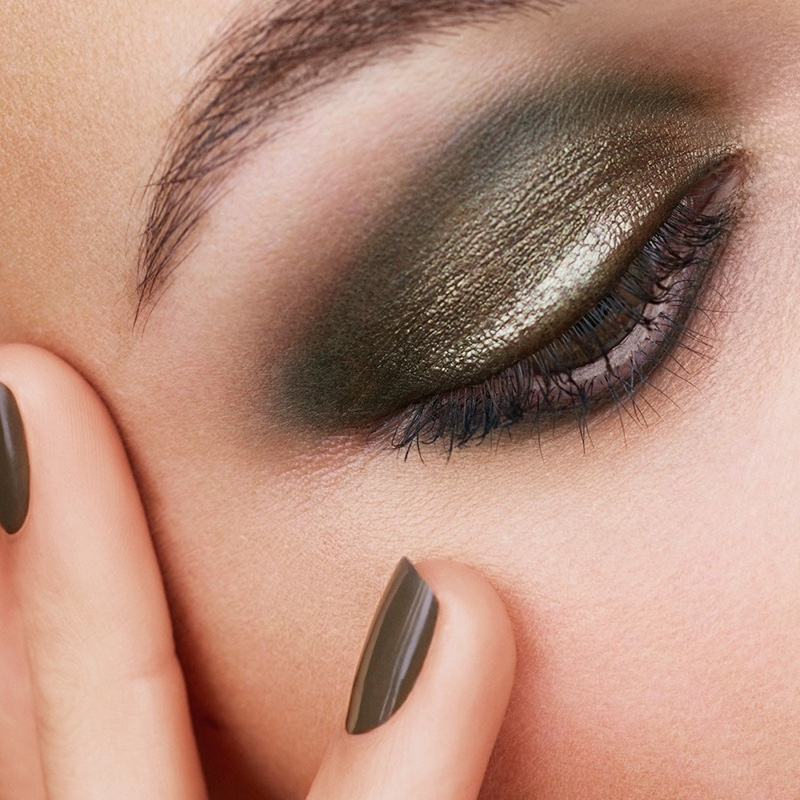 Shimmering green eyeshadow and nail polish stands out in Chanel Makeup's fall 2021 collection.