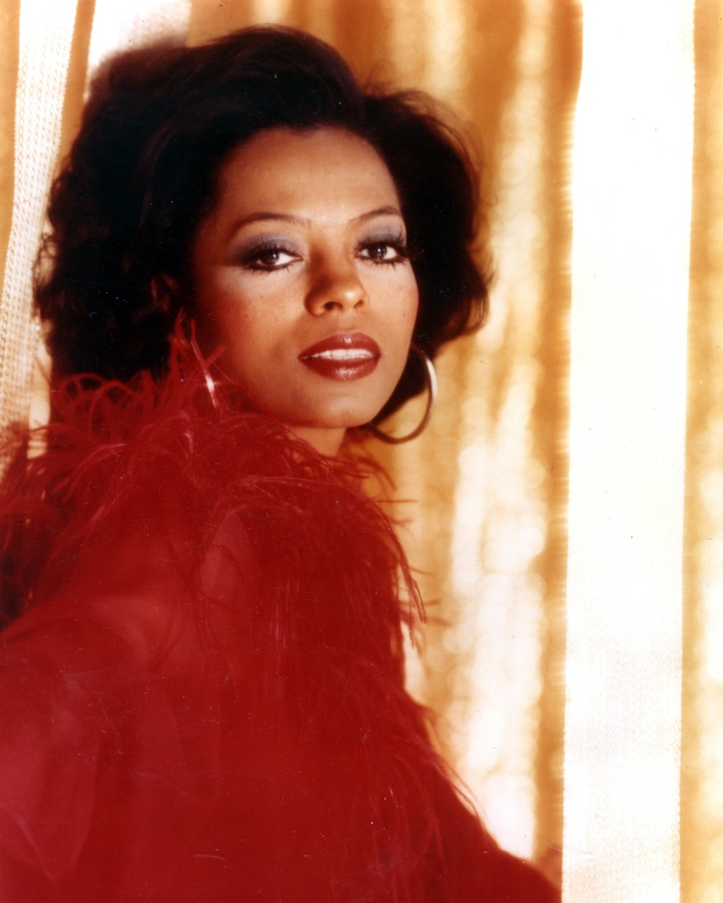 Diana Ross in 1970 wearing hoop earrings and a red outfit.   Photo Credit: Pictorial Press Ltd / Alamy Stock Photo