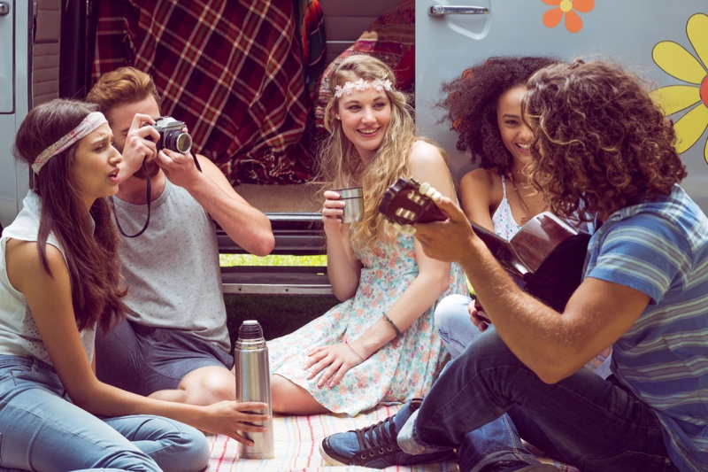 Hipster Group Festival Camper Playing Guitar