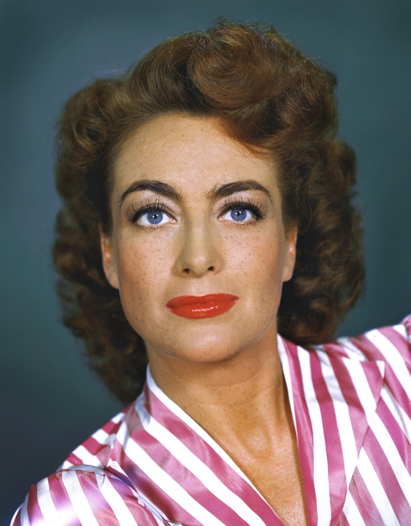 Joan Crawford shows off bold curls in the 1940s. Photo: PictureLux / The Hollywood Archive / Alamy Stock Photo