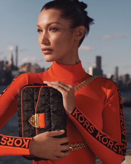 Posing with the SoHo bag, Bella Hadid fronts MICHAEL Michael Kors fall-winter 2021 campaign.