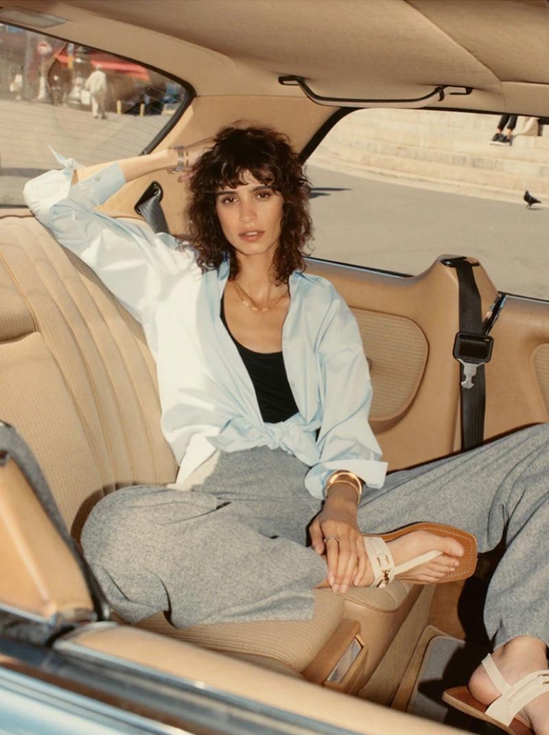 Posing in a car, Mica Arganaraz wears Massimo Dutti's fall 2021 styles.