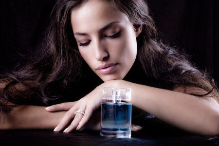 Model Dark Hair Perfume Bottle Blue