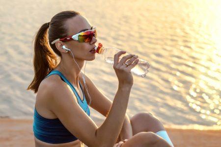 Model Drinking Water Activewear Style Visor Sunglasses