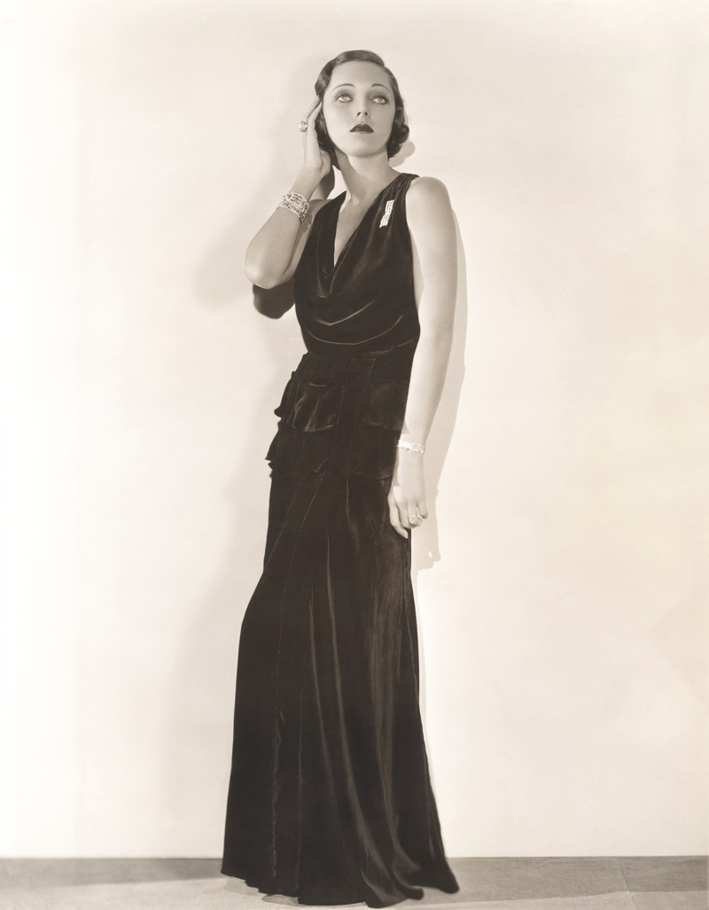Model poses in long column dress with a defined waist for a 1930s look. Photo: Shutterstock.com