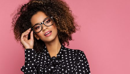 Model Wearing Black Framed Glasses and Polka Dot Blouse