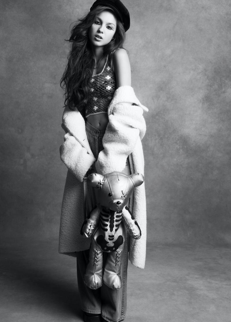 Singer Olivia Rodrigo wears Prada coat, Guess Vintage pants, and Tiffany & Co. Necklace. Image: Courtesy of V Magazine / Inez & Vinoodh