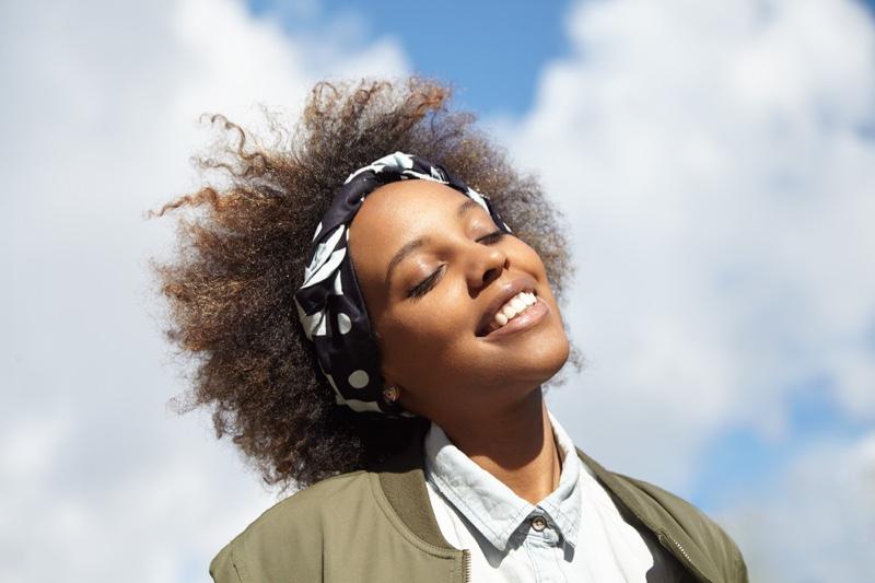 Smiling Black Woman Outside Headband Natural Hair