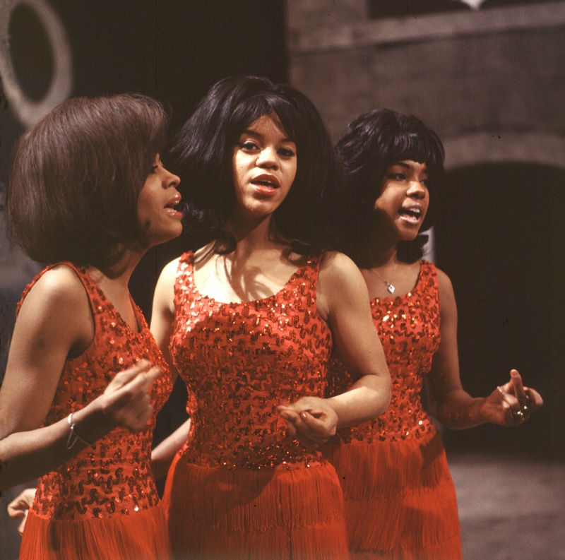 Diana Ross and The Supremes wearing red dresses in the 1960s. The group's glamorous outfits made them stand out.   Photo Credit: Pictorial Press Ltd / Alamy Stock Photo