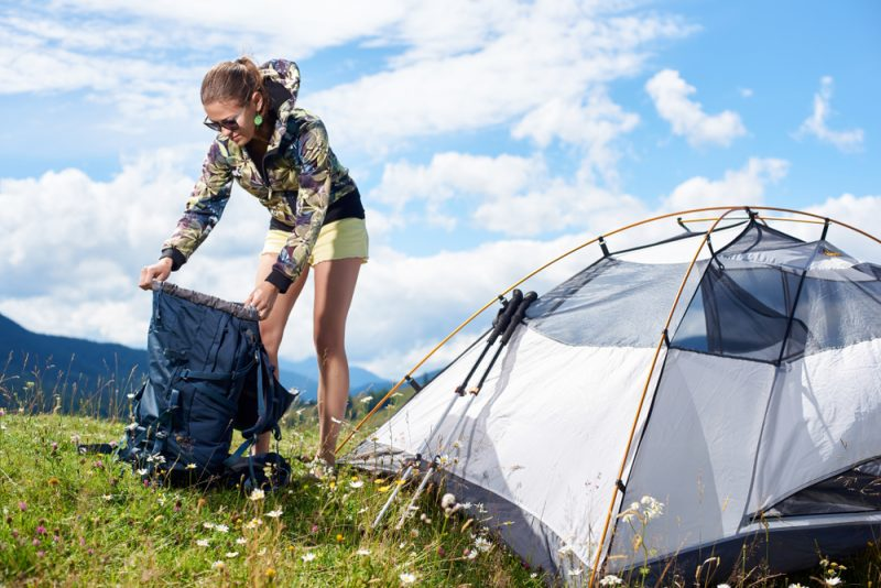Woman Camping Opening Bag