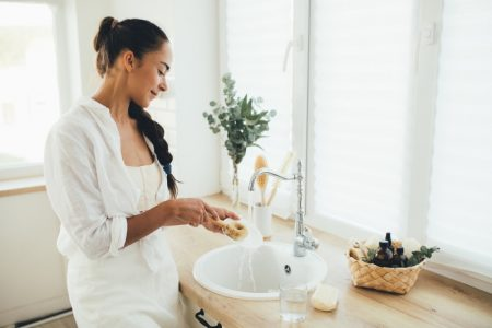 Woman Cleaning Dishes Natural Home