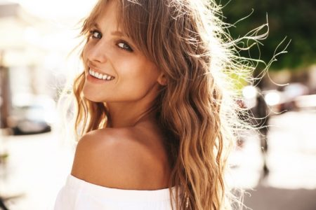 Woman Smiling Natural Makeup Wavy Hair